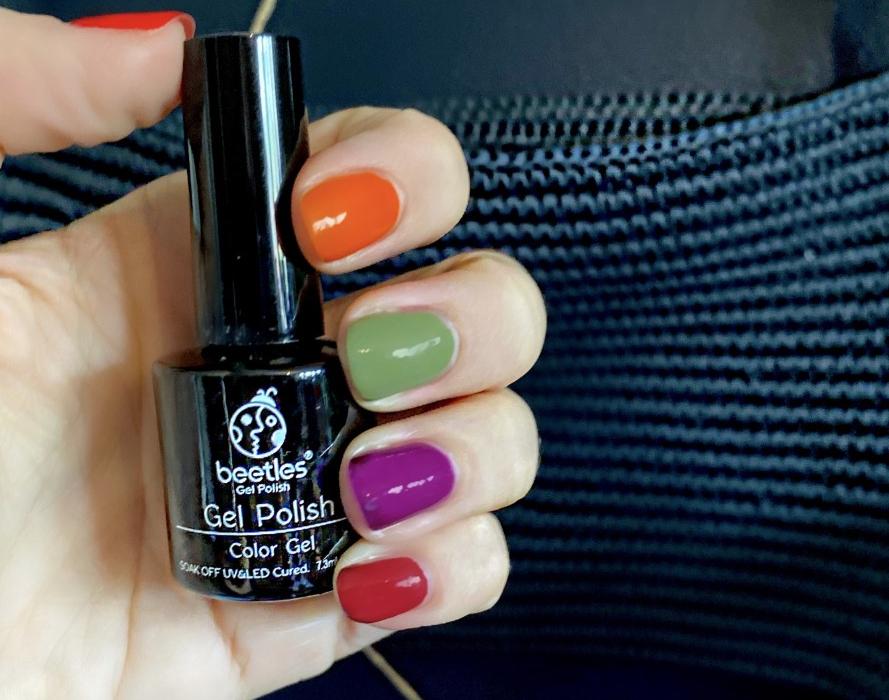 Girl holding Beetles Gel nail polish led lamp autumn manicure