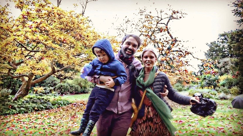 Family having a day out an Autumn walk in Oxfordshire surrounded by beautiful colourful leaves.