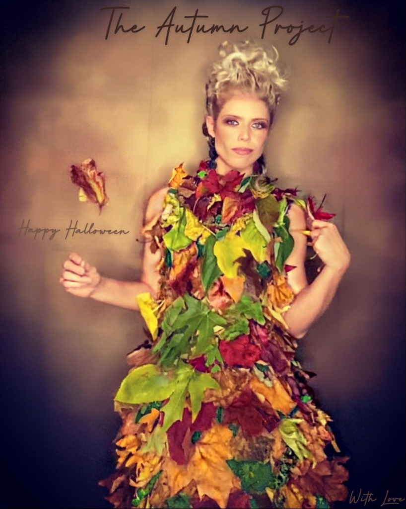A woman wearing Mother Nature's dress - a dress made out of elegant Autumn leaves
